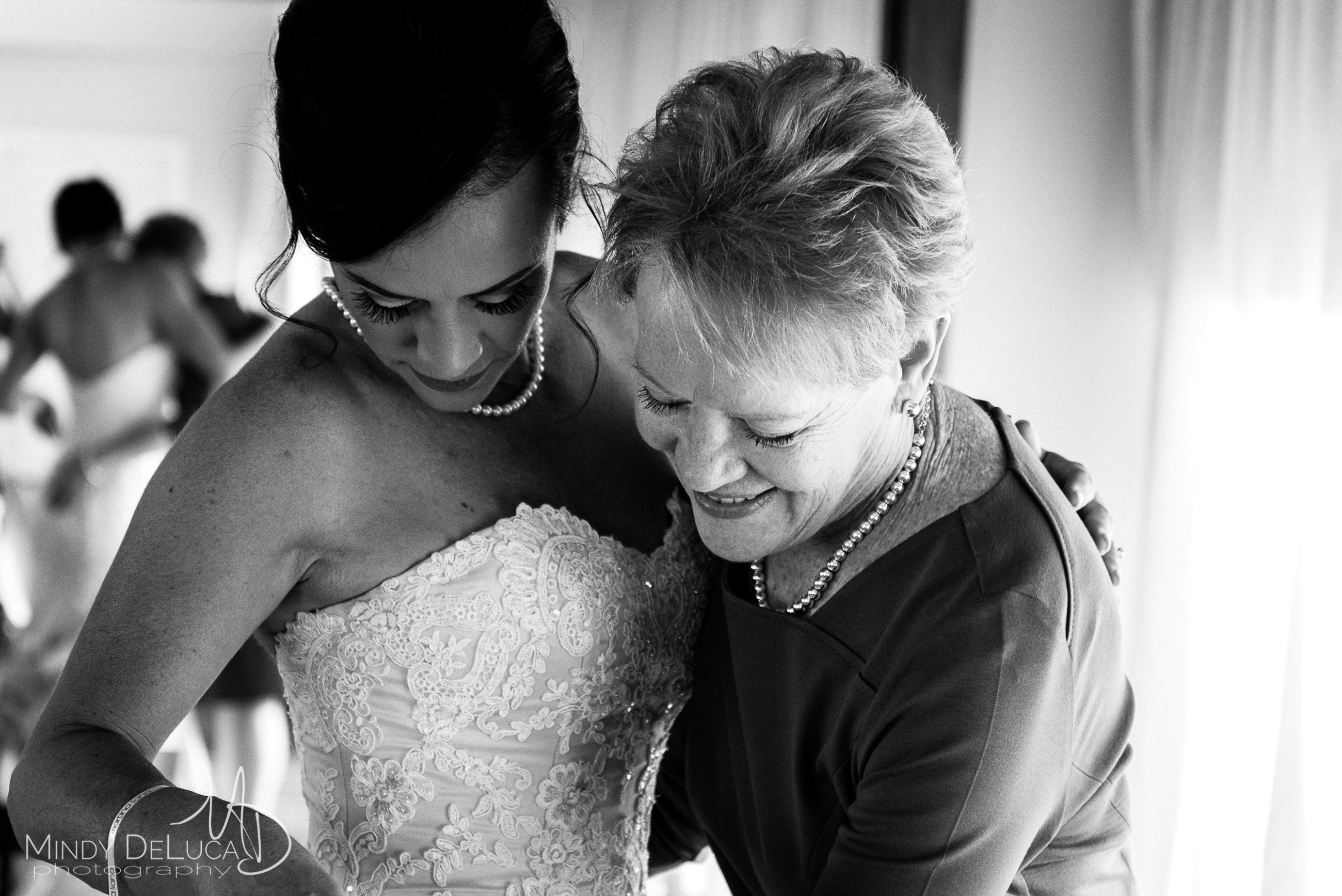 Mother of the bride helps her