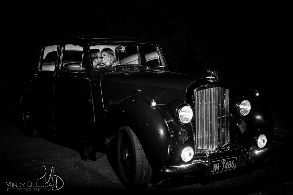 Wedding classic car kiss